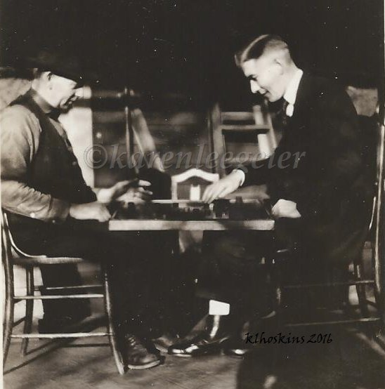 Butterfield Geier_elmer-and-carl-playing-checkers-on-porch_1920-or-so_tacoma