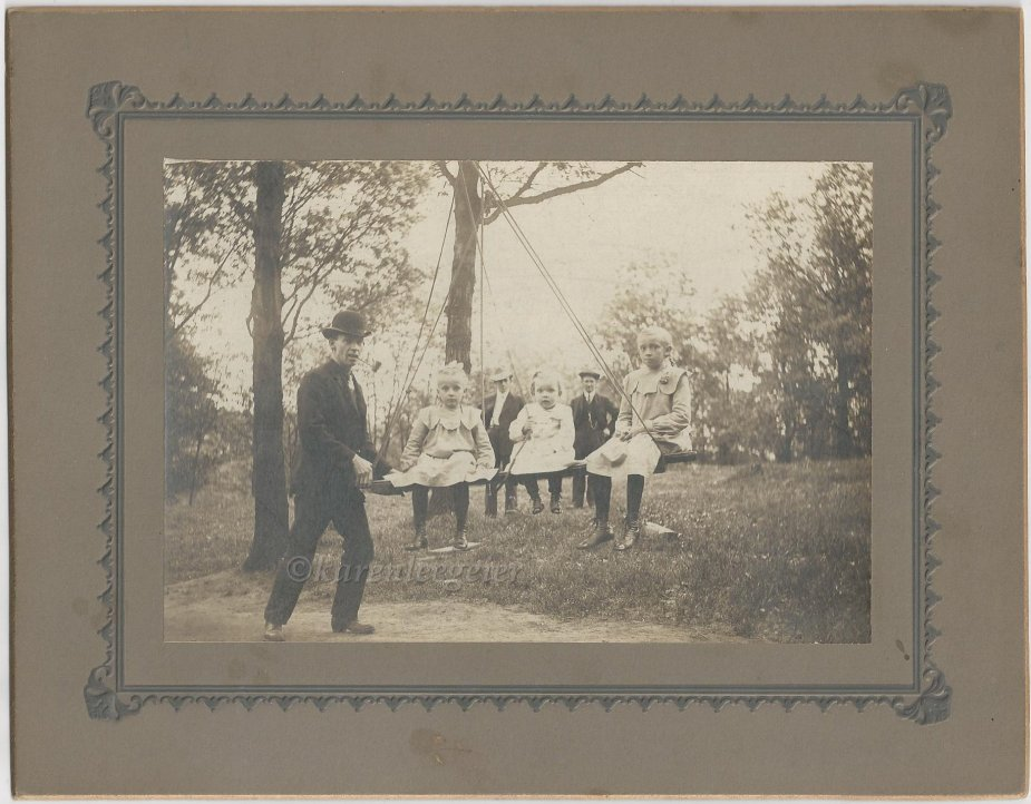Butterfield_Elmer and daughters on swing Lalla Hazel and Lillian_Minneapolis