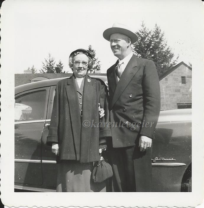 haggie_Lalla and Ed standing next to car_1950s