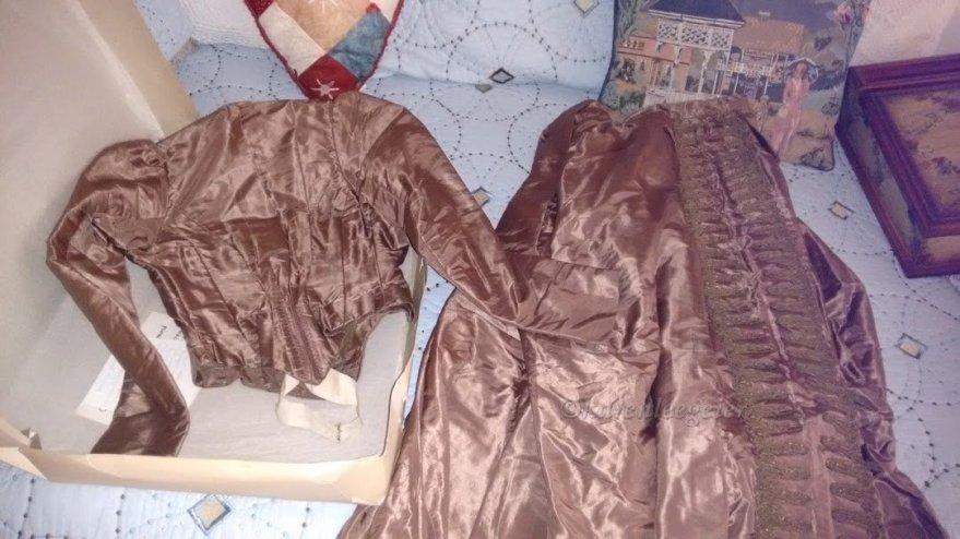 Carrie's brown, taffeta dress
